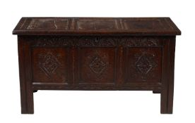 † A Charles II carved oak triple panel coffer