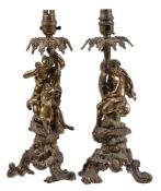 A pair of gilt metal figural table lamps in Rococo Revival taste