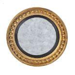 A Regency giltwood convex wall mirror