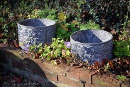 A pair of circular lead planters