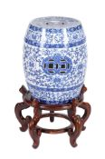 A Minton's blue and white printed pottery garden seat in the Chinese manner