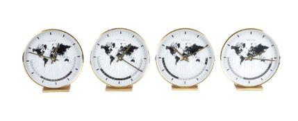A suite of four German 'World Time' desk clocks