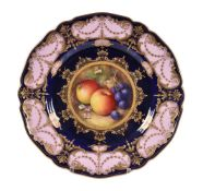 A Royal Worcester dessert plate painted with autumnal windfall fruit by R. Seabright