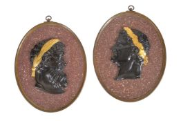 A pair of faux porphyry and metal mounted plaster profile reliefs in Grand Tour taste