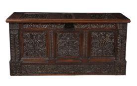 A carved oak plank coffer