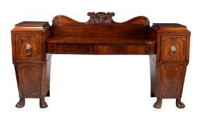 A Regency mahogany pedestal sideboard
