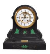 A black marble and malachite inset mantel clock