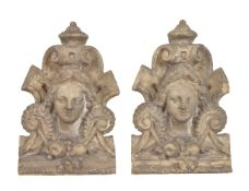 A pair of painted plaster wall plaques in 18th century taste