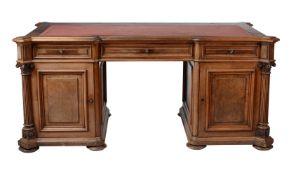 A Continental walnut twin pedestal desk
