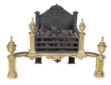 A cast iron and brass mounted fire grate in 18th century taste