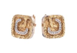 A pair of diamond set cufflinks