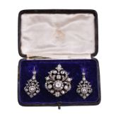 A Victorian diamond brooch and earrings