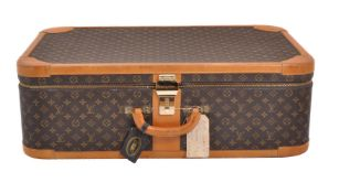 Louis Vuitton, a coated monogrammed canvas suitcase
