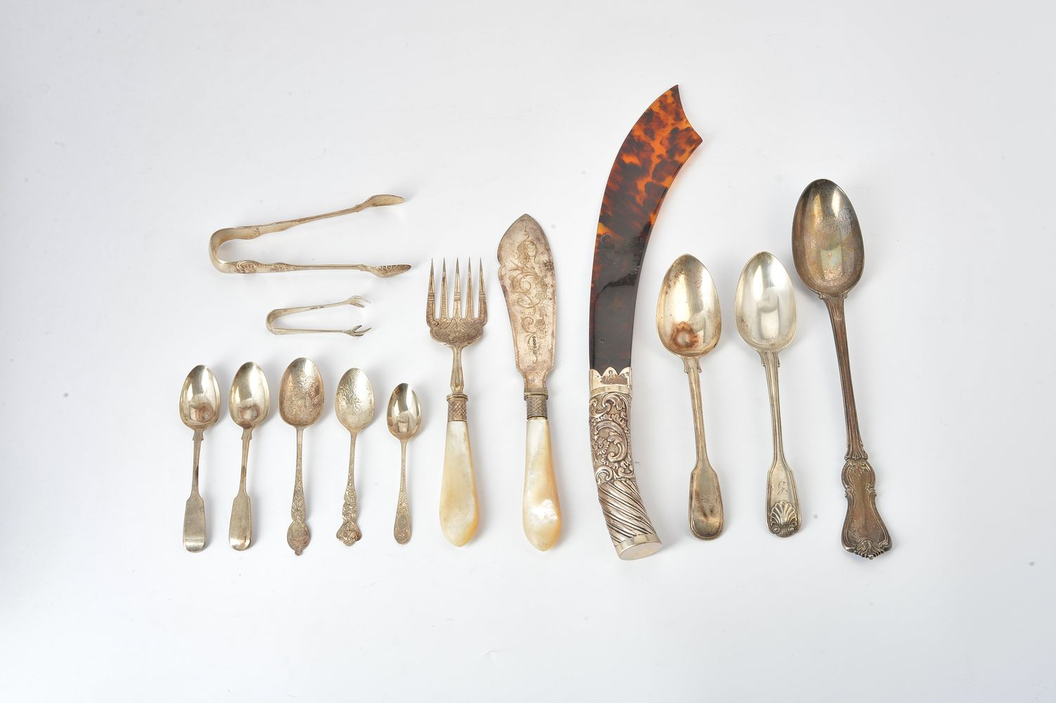 Lot 651 - ϒ A late Victorian silver handled tortoiseshell page turner and various flatware