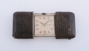 Unsigned, Silver and leather mounted purse watch