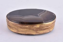 A gilt metal and banded agate oval box