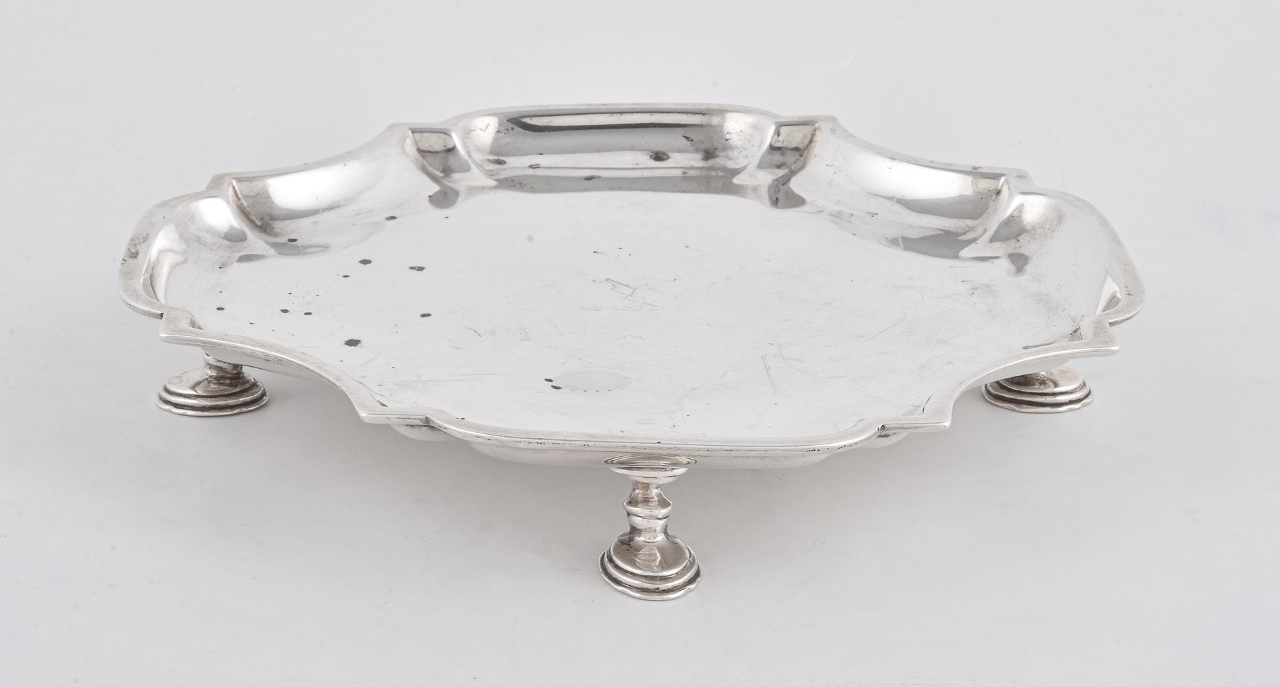 Lot 683 - A silver waiter by William Comyns & Sons