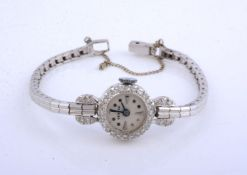 Unsigned,Lady's white gold coloured and diamond cocktail watch