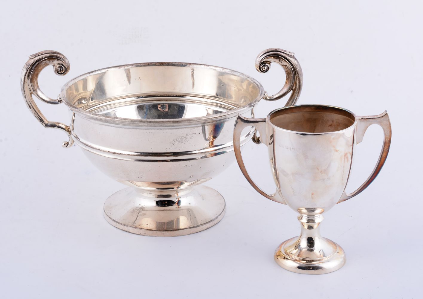 Lot 690 - Two silver twin handled trophy cups