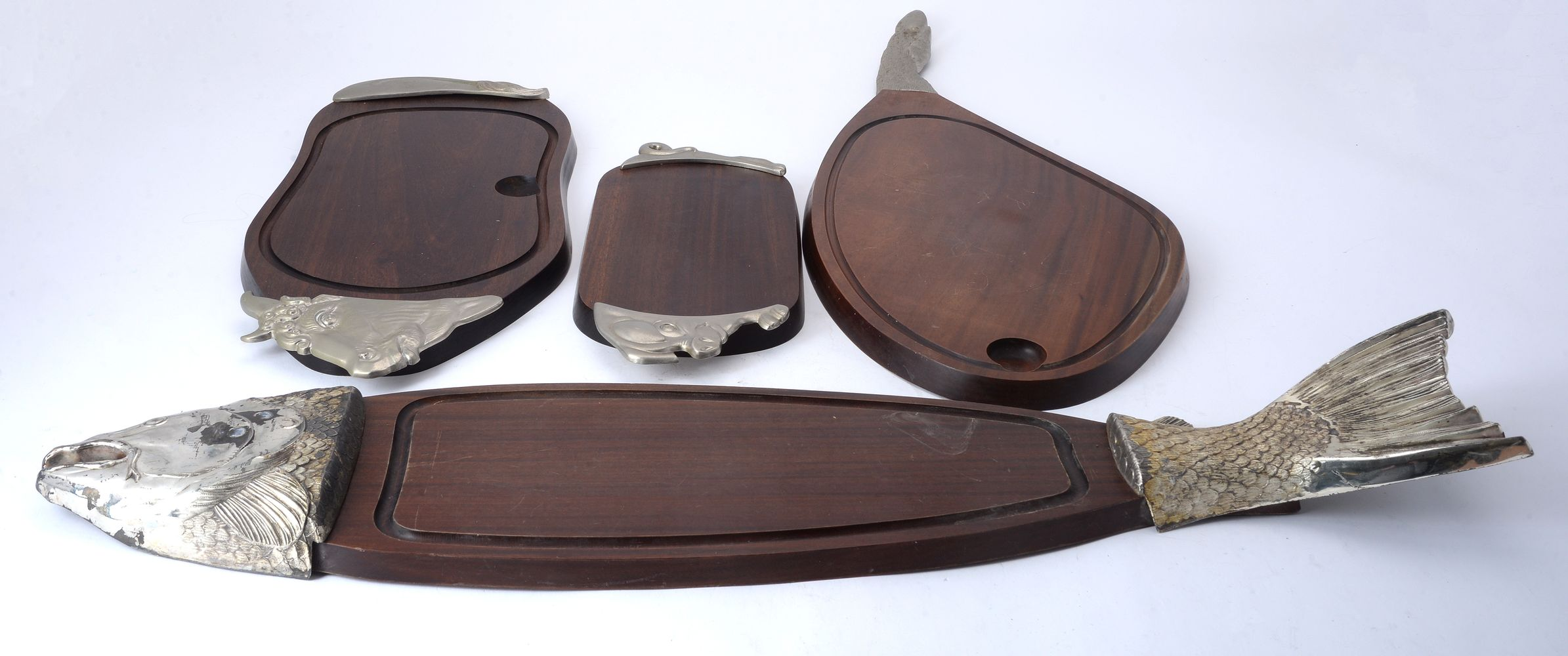 Lot 707 - Four metal mounted wooden carving platters