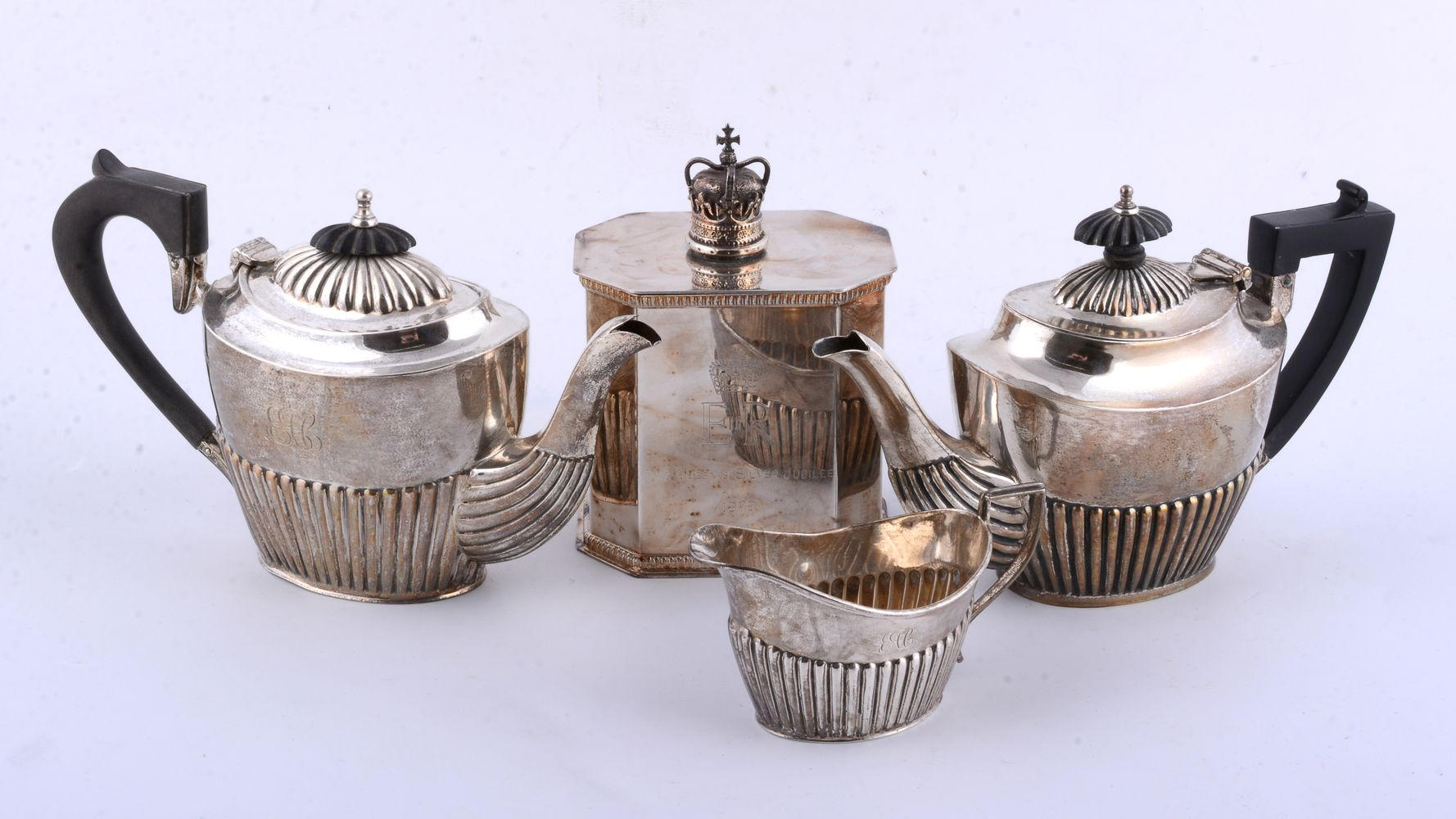 Lot 691 - Two similar silver oval half reeded tea pots and a cream jug