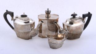 Two similar silver oval half reeded tea pots and a cream jug