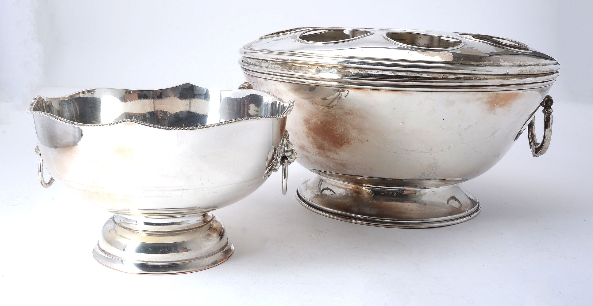 Lot 706 - An electro-plated circular footed eight bottle champagne cooler