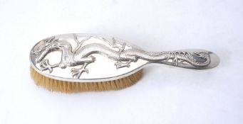 A Chinese export silver hair brush by Wang Hing & Co.