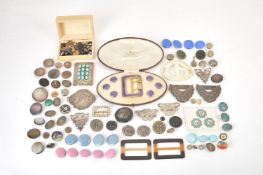 A collection of buttons and buckles