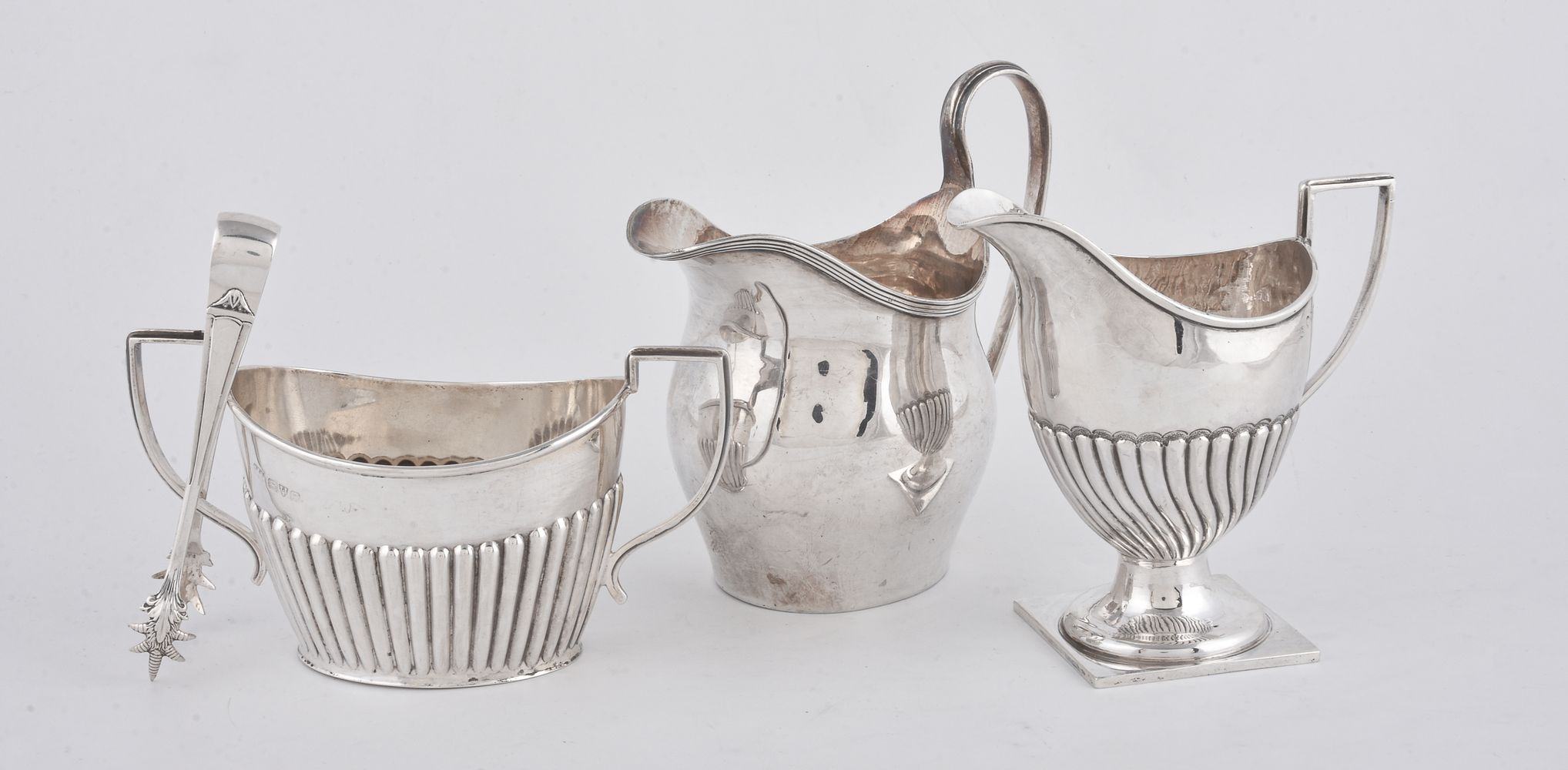 Lot 687 - A silver swollen oval cream jug by Nathan & Hayes