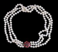 A three row cultured pearl and garnet necklace