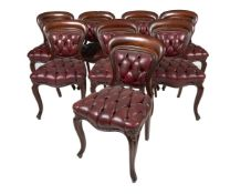 A set of eight Victorian mahogany and leather upholstered dining chairs