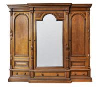 A late Victorian oak and ebonised compactum wardrobe