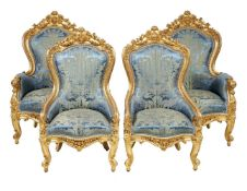 A French carved giltwood and composition salon suite in Louis XV style