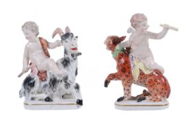 A pair of Derby figures of putti