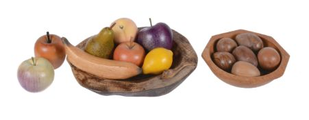 A collection of eight various models of fruit