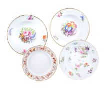 A group of four Derby porcelain plates