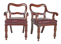 A pair of early Victorian mahogany balloon back armchairs