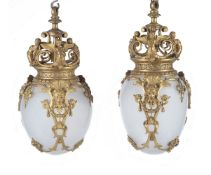A pair of French opaline glass and gilt metal mounted pendant ceiling lights in Louis XIV taste