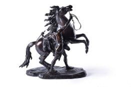 After Guillaume Coustou the Elder (French 1677 - 1746), a patinated bronze model of one of the Marly