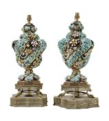 A pair of Continental porcelain and gilt metal mounted vase table lamps