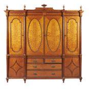 ϒ An Edwardian satinwood, tulipwood, and rosewood banded wardrobe, in George III style,