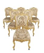 A set of twelve giltwood side chairs in Louis XVI style