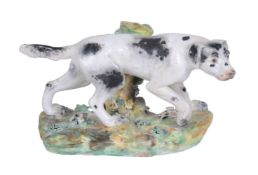 A Derby model of a pointer painted with black patches