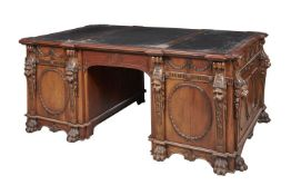 A carved mahogany twin pedestal partner's desk in George III style