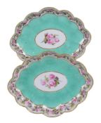 A pair of Derby porcelain lozenge shaped turquoise ground serving dishes painted with pink roses by