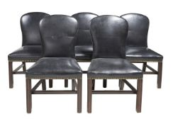 A set of eight mahogany and leather upholstered dining chairs in George III style