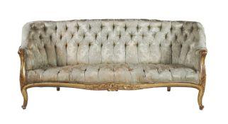 A Victorian giltwood sofa