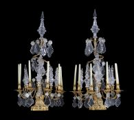 A pair of cut glass and gilt metal six light lustre candelabra in Louis XV taste