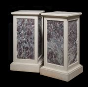 A pair of stone and fleur de pêcher marble inset plinths